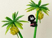 bananenboom met karikatuur zwart poppetje